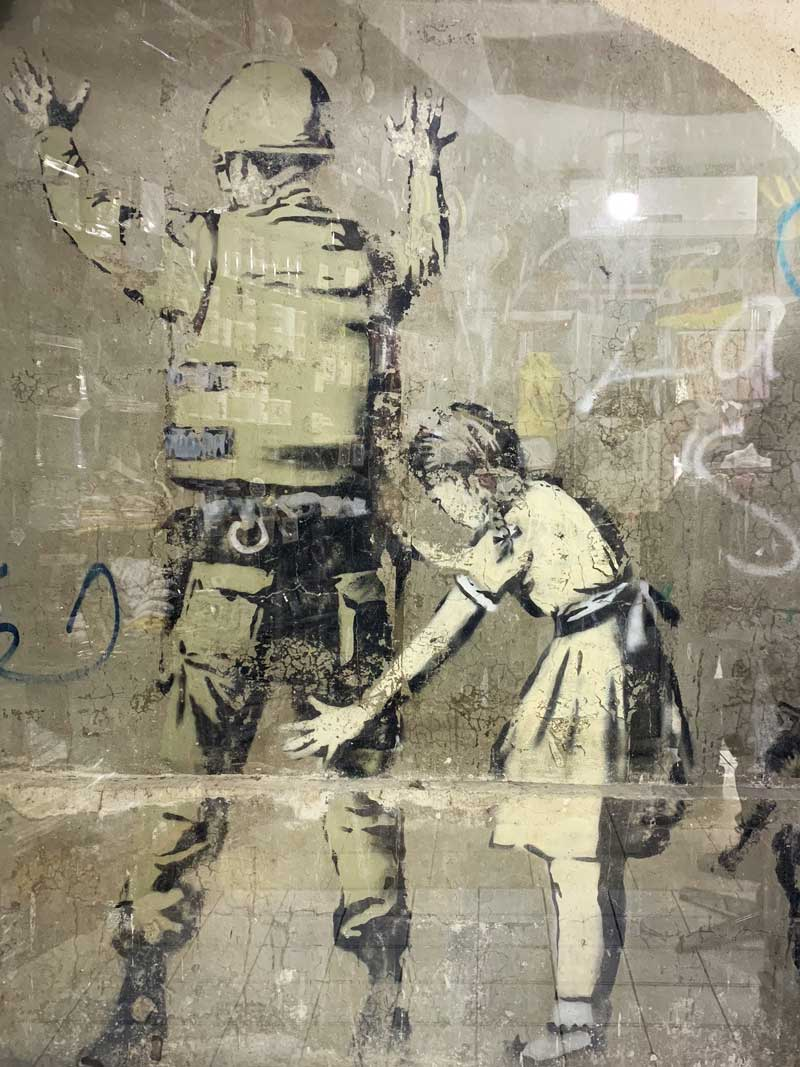 Girl Frisking Soldier Banksy Mural in Bethlehem Streetart und Murals in Palaestina www.gindeslebens.com